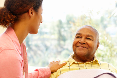 senior man smiling to caregiver