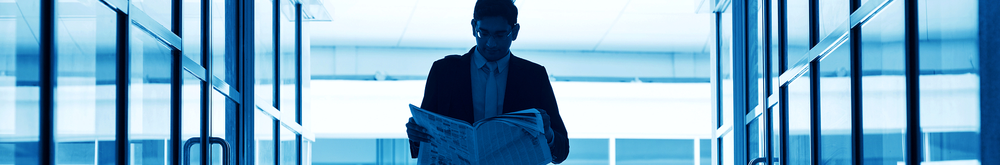 man reading a news